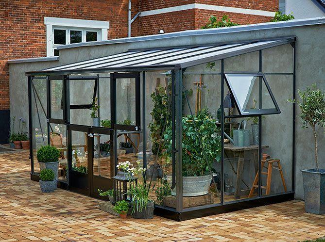 installer une serre dans le jardin ou sur la terrasse elle d coration. Black Bedroom Furniture Sets. Home Design Ideas