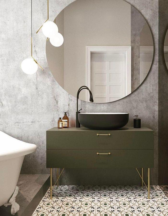 Le miroir rond dans une salle de bains pour jouer sur les volumes