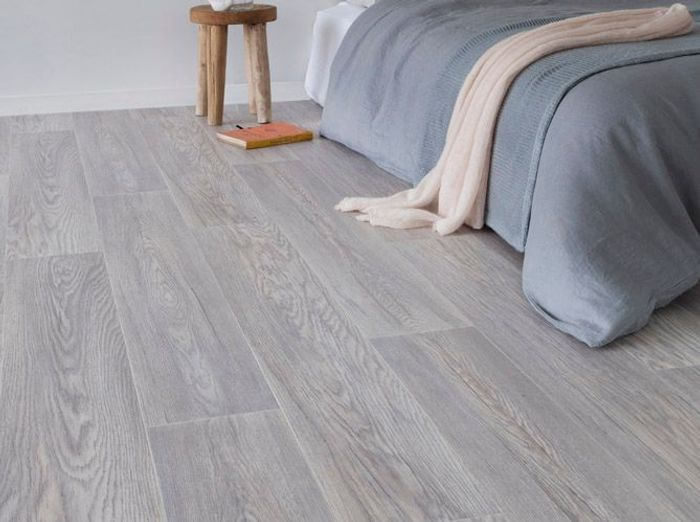 Ces sols qui imitent le parquet la perfection elle for Parquet imitation carrelage gris
