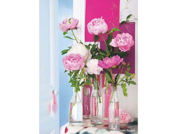 Fleurs mariage salle bouteilles